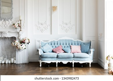 Livingroom interior  mock up with blue  velvet sofa and pink pastel  pillows on white wall background with free space. - Image