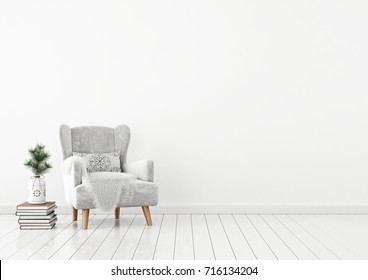 Livingroom interior with velvet armchair, pillow, pile of books and pine branch in vase on white wall background. 3D rendering.