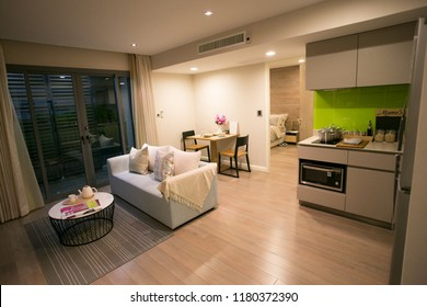 living-room and kitchen with dining table in condominium.