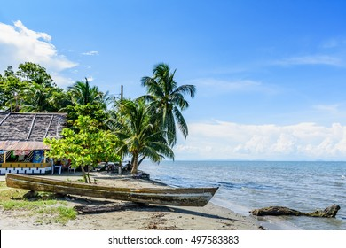 Livingston, Guatemala - August 31, 2016: Boat pulled ashore on beach in Caribbean town of Livingston