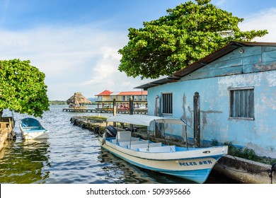 Livingston, Guatemala - August 31, 2016: Riverside moored boats in late afternoon light on Rio Dulce in Caribbean town of Livingston, Guatemala