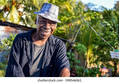 Livingston, Guatemala - March 7, 2015: Garifuna man smiles into the camera on March 7, 2015 in Livingston, Guatemala. Garifuna are the group of indigenous people of African descent in Central America