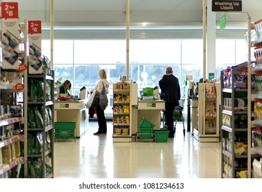 LIVINGSTON, SCOTLAND, UK - APRIL 19, 2018. Asda / Walmart Supermarket. People shopping in Asda supermarket, one of the biggest chains of supermarkets in United Kingdom.