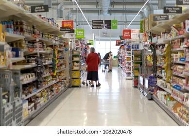 LIVINGSTON, SCOTLAND, UK - APRIL 19, 2018. Asda / Walmart Supermarket. People shopping in Asda supermarket, one of the biggest chains of supermarkets in United Kingdom.