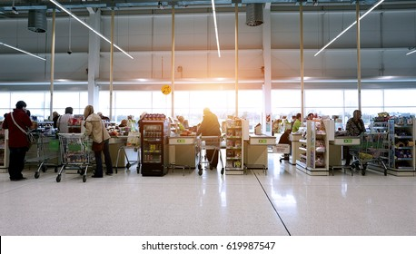 LIVINGSTON, SCOTLAND, UK - APRIL 7, 2017. Asda / Walmart Supermarket. People shopping in Asda supermarket, one of the biggest chains of supermarkets in United Kingdom.
