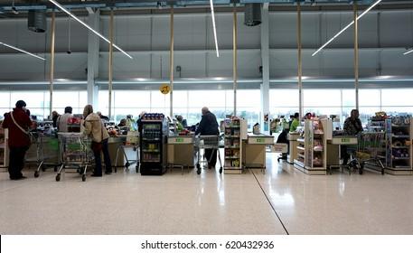 LIVINGSTON, SCOTLAND, UK - APRIL 7, 2017. Asda / Walmart Supermarket. People shopping in Asda supermarket, one of the biggest chains of supermarkets in United Kingdom.