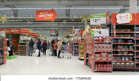 LIVINGSTON, SCOTLAND, UK - DECEMBER 9, 2017. Customers are shopping at Asda / Walmart Supermarket during busy Christmas / New Year shopping time.
