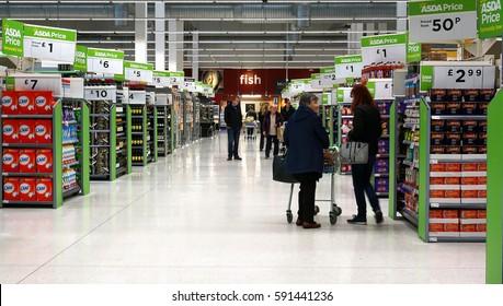 LIVINGSTON, SCOTLAND, UK - FEBRUARY 28, 2017. Customers are shopping at Asda / Walmart Supermarket.