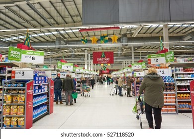LIVINGSTON, SCOTLAND, UK - NOVEMBER 30, 2016. Customers are shopping at Asda / Walmart Supermarket during busy Christmas shopping time.