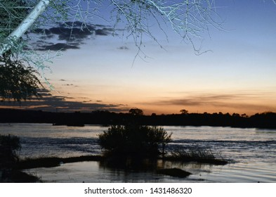 Livingstone, Zambia, Africa. June 2014. Sunset over the Zambezi River as seen from the Royal Livingstone Hotel.