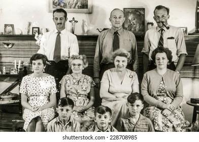 LIVINGSTONE, ZAMBIA, CIRCA 1958: Vintage photo of big family indoor
