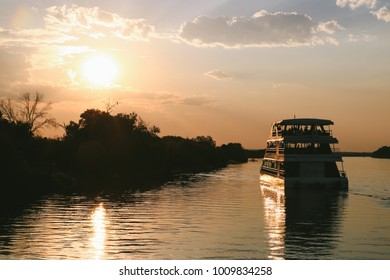 LIVINGSTONE, ZAMBIA - CIRCA NOVEMBER 2017: A sunset boat cruise on the Livingstone (Zambia) side of the Zambezi river.