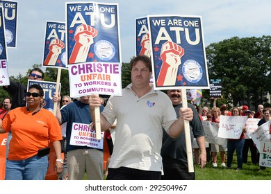 LIVINGSTON,NJ-JUNE 30:Protesters disapprove of New Jersey Gov. Chris Christie's decision to seek the Republican Nomination for President of the USA at Livingston,NJ High School,on June 30,2015.