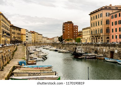 Livorno, Italy - 2018. Picturesque view of the canal with boats within the city in the town Livorno, Tuscany, Italy.