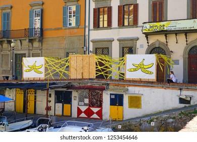 LIVORNO, ITALY -30 SEP 2018- View of signs for the 2018 Il Senso Ridicolo humor festival in Venezia Nuova in Livorno, a port city on the Ligurian Sea in Tuscany, Italy.