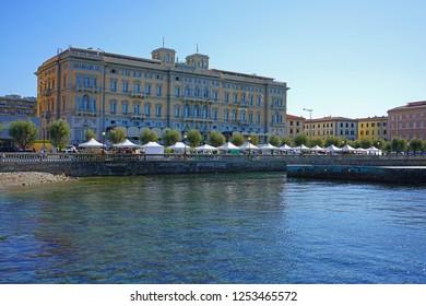 LIVORNO, ITALY -30 SEP 2018- View of the landmark Grand Hotel Palazzo Livorno overlooking the Terrazza Mascagni in Livorno, a port city on the Ligurian Sea in Tuscany, Italy.