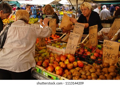 LIVORNO, ITALY - APR 23, 2018 - Shoppers buying fresh fruit in the market of Livorno, Italy