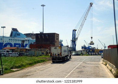 LIVORNO, ITALY - APR 23, 2018 - Cranes in the industrial harbor of Livorno, Italy