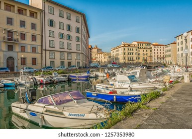 LIVORNO, Italy - april 28, 2018: Buildings, canals and boats in the Little Venice district of Livorno, Tuscany, Italy. The Venice quarter is the most charming and picturesque part of the city.