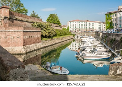 """LIVORNO, Italy - april 28, 2018: View of the """"New"""" Fortress of Livorno. The moat surrounds the fortifications in the Venezia Nuova district. The first, Fortezza Nuova, was built between 1590-1604."""