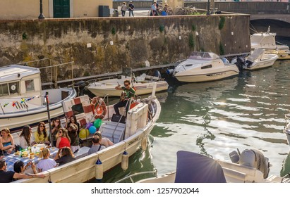 LIVORNO, Italy - april 28, 2018a. Tourists on the boat in the Livorno Canal, Venice district. The Venice quarter is the most charming and picturesque part of the city of Livorno in Tuscany, Italy.