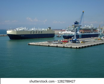 Livorno, Italy, June 28, 2015.  Long shot of large EUKOR car carrier docking in Italian port of Livorno.  Summers day.  Livorno, Italy, June 28, 2015