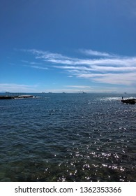 Livorno, panoramic view of the sea from Mascagni Terrace, Livorno (Tuscany, Italian coast). The sun shines high in the clean blue sky of spring. The water of the sea is crystal and transparent.