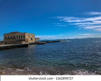 Livorno, panoramic view of the sea from Mascagni Terrace, Livorno, Tuscany, Italy 07/04/2019. The sun shines high in the clean blue sky of spring. The water of the sea is crystal and transparent.