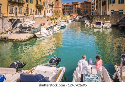 LIVORNO, Tuscany, Italy- April 28, 2018: Buildings, canals and boats in the Little Venice district of Livorno, Italy. The Venice quarter is the most charming and picturesque part of the city.