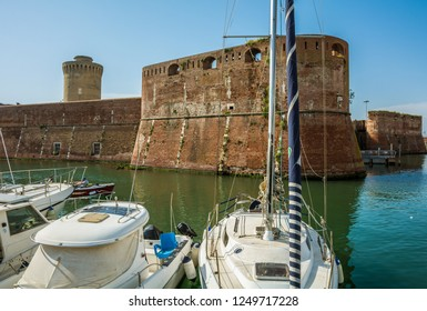 LIVORNO, Tuscany, Italy - april 28, 2018: View of the Fortezza Vecchia, an Old Fortress with a tower located in Livorno, on an area that many call little Venice, Tuscany, Italy