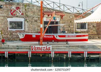 LIVORNO, Tuscany, Italy - april 28, 2018: rowing boat exposed in the Venice district of Livorno, Tuscany, Italy. rowing boat used for the Palio of Livorno.