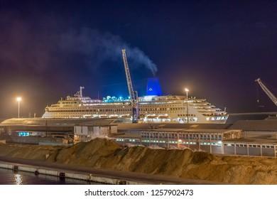 LIVORNO, Tuscany, Italy - april 28, 2018: A cuise ship docks in Livorno harbor, Tuscany, Italy. suggestive night image.