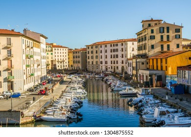 Livorno, Tuscany/Italy - 26.12.2018: Italian seaport Livorno. New Venice district. Bright colorful houses and boats. Reflection in water.