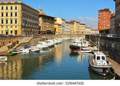 Livorno,Tuscany, Italy. July.06.2018: picturesque district Venezia Nuova in Livorno. View on boats in city channel.