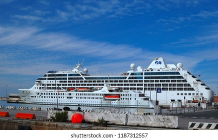 Livorno/Tuscany/Italy - 12 October 2016:  Livorno is an Italian port city on the west coast of Tuscany. Beautiful white giant luxury cruise ship on stay at Livorno harbor.