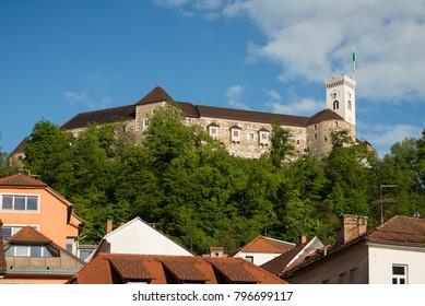 Ljubljana castle and old town apartments roof tops in Ljubljana, Slovenia