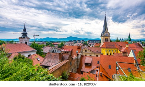 Ljubljana church tower aerial view. Panorama of city with beautiful historical church. The Slovenian mountains in the background. Dramatic colors and clouds. Look to Slovenia capital city.