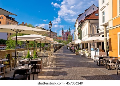Ljubljana riverfront promenade walkway summer view, capital of Slovenia