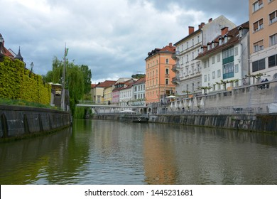LJUBLJANA SLOVANIA 05 16 19: View of the old houses on Ljubljanica river bank in downtown, beautiful architecture,