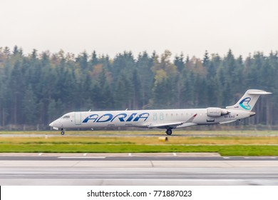 Ljubljana, Slovenia - 19.10.2016: Slovene national airline Adria Airways' Canadair Regional Jet CRJ900, S5-AAO taking off at Ljubljana - Brnik Airport.