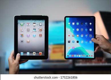 Ljubljana / Slovenia - 2020 June 2: Comparison of the old First iPad 2010 versus the new iPad Pro 2020