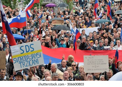 LJUBLJANA, SLOVENIA, 7 July 2014: Crowd of people gather for demonstration with Slovenian flags and banners to protest in support of Slovenian politician, Janez Jansa.