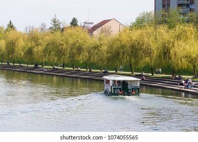 Ljubljana / Slovenia - April 14 2018: Tourist boat is taking tourist on a cruise on Ljubljanica river in Ljubljana, Slovenia