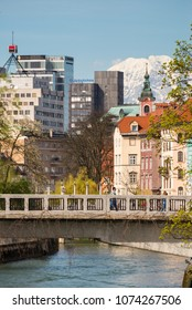 Ljubljana / Slovenia - April 14 2018: Bridge over Ljubljanica river and old buildings on the banks of the river in Ljubljana, Slovenia
