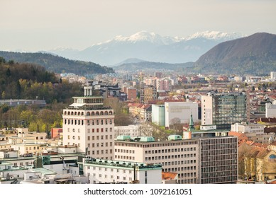 Ljubljana / Slovenia - April 14 2018: Neboticnik  building and Ljubljana old town with mountains as a backdrop in Ljubljana, Slovenia