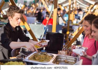 Ljubljana, Slovenia - April 15: People enjoing outdoor street food festival of Odprta kuhna, Open kitchen event, on April 15th, 2016 in Ljubljana, Slovenia.