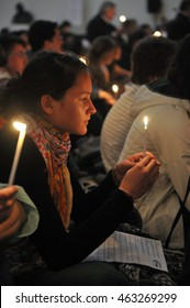 LJUBLJANA, SLOVENIA (April 2012): Taize Pilgrimage of Trust Meeting for young people. Girl holding a candle for prayer.