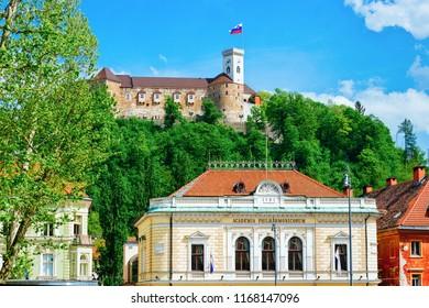 Ljubljana, Slovenia - April 28, 2018: Academia Philharmonic and Old castle on Castle hill in the historical center of Ljubljana, Slovenia