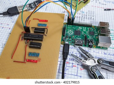 LJUBLJANA, SLOVENIA - APRIL 6, 2016: Illustrative editorial photo of a Raspberry Pi single board computer used in a tabletop experiment, connected with home-brewed circuit with some of the LEDs on.