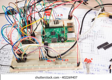 LJUBLJANA, SLOVENIA - APRIL 6, 2016: Illustrative editorial photo of a Raspberry Pi single board computer used in a tabletop experiment, connected with circuit on a electronics prototype breadboard